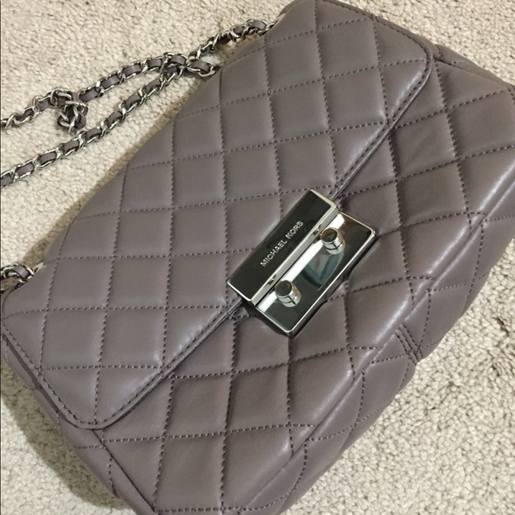 2bb7a12e6a9c Michael Kors Sloan small Quilted Leather Crossbody.  M_5bd5f6d23c98447fcfe0f582